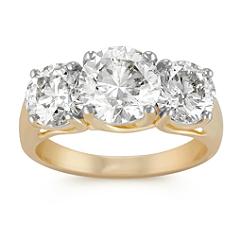 Opulent Round Diamond Three-Stone Ring in Yellow Gold
