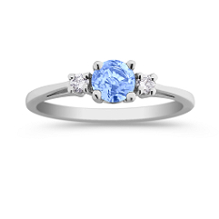 Round Ice Blue Sapphire and Diamond Three-Stone Ring
