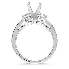 Three-Stone Round Diamond Engagement Ring with Pavé Setting in Platinum