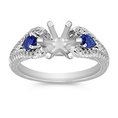 Vintage Pear Shaped Sapphire and Round Diamond Platinum Engagement Ring