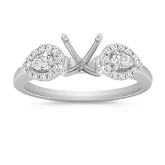 Three-Stone Pear Shaped and Round Diamond Engagement Ring with Pave Setting
