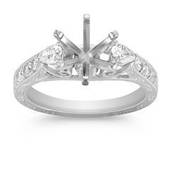 Vintage Pear-shaped and Round Diamond Platinum Engagement Ring