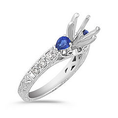 Vintage Pear Shaped Sapphire and Round Diamond Engagement Ring