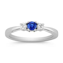 Round Sapphire and Diamond Three-Stone Ring
