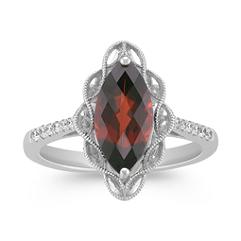 Marquise Garnet and Round Diamond Ring