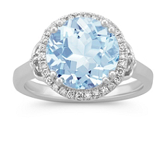 Round Aquamarine and Diamond Halo Ring