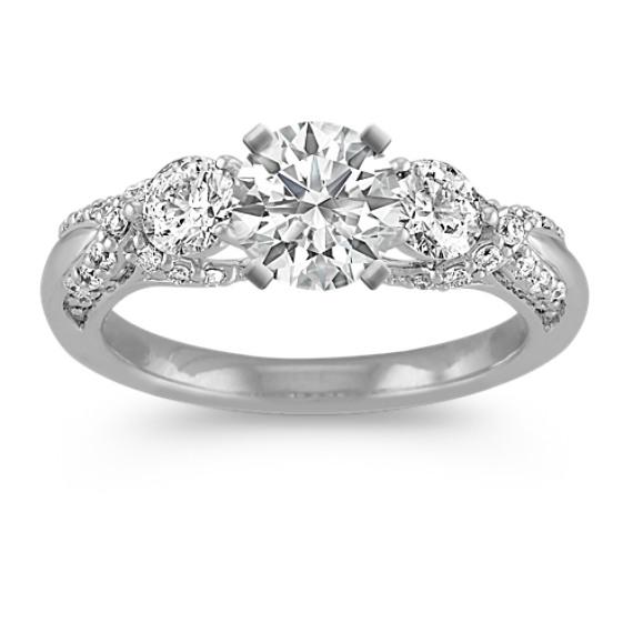 Round Diamond Three-Stone Engagement Ring with Pavé Setting