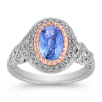 Oval Ice Blue Sapphire and Round Diamond Ring in Two-Tone Gold