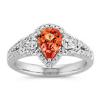 Pear-Shaped Salmon Sapphire, Pear-Shaped and Round Diamond Three-Stone Ring