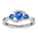 Round Kentucky Blue Sapphire and Diamond Swirl Three-Stone Ring