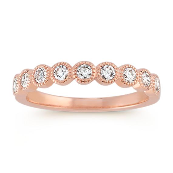 bezel set diamond wedding band in 14k rose gold
