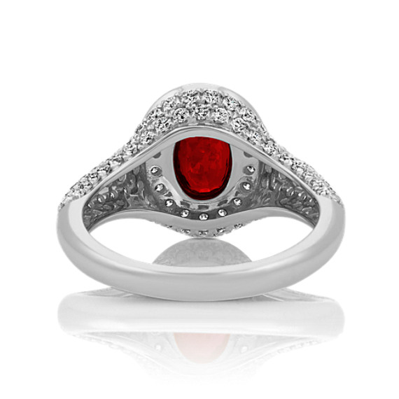 Oval Ruby and Round Diamond Halo Ring