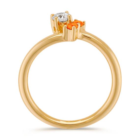 Round Orange Sapphire and Diamond Three-Stone Ring