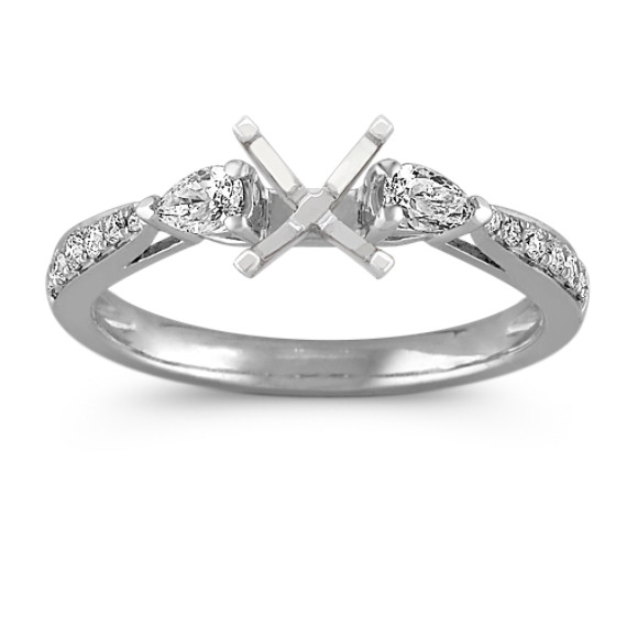 Three-Stone Pear Shaped and Round Diamond Engagement Ring in Platinum