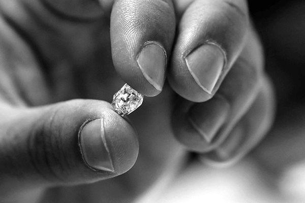 Hand holding a diamond