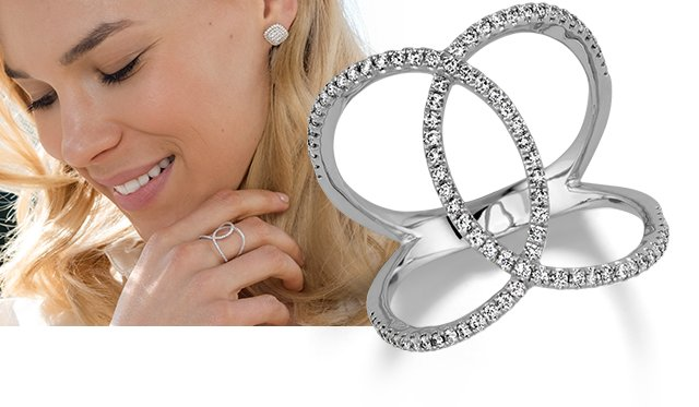 Image of a diamond ring and a woman wearing diamond jewelry