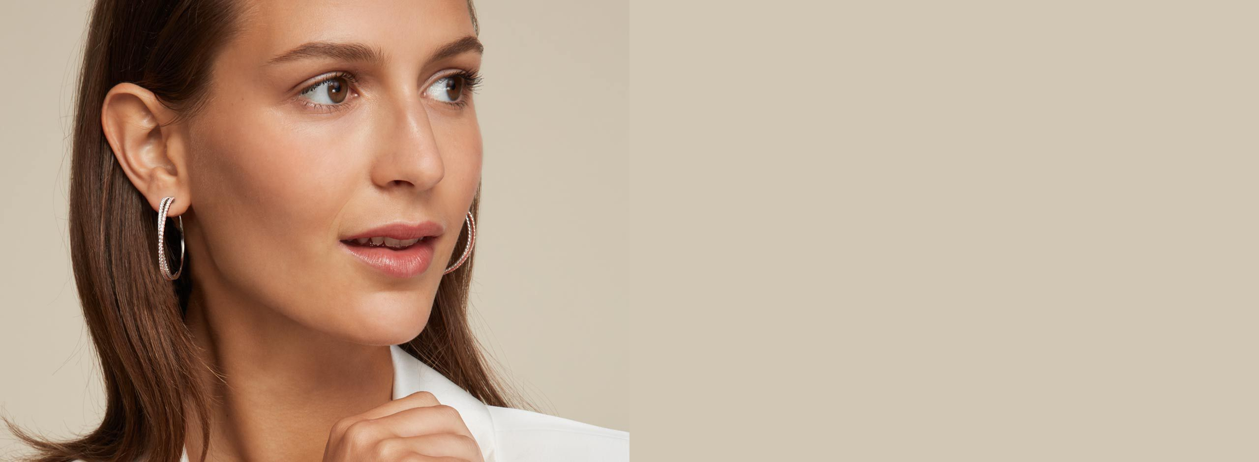 Side Profile of Woman Wearing Double Hoop Diamond Earrings