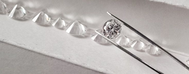Top View of Loose Diamond Held with Tool