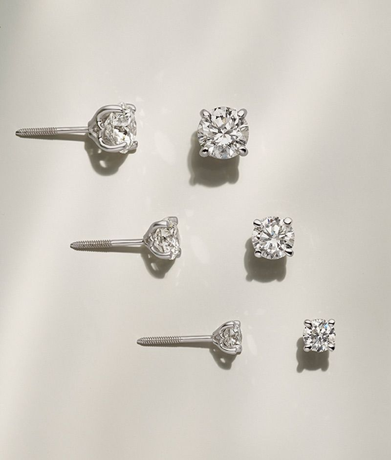 Three pairs of diamond stud earrings