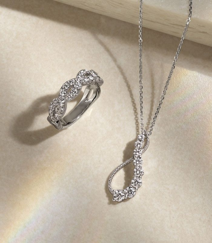 Mobile image of a diamond fashion pendant and fashion ring