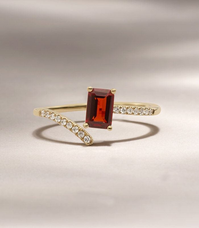 Mobile image of a garnet and diamond fashion ring