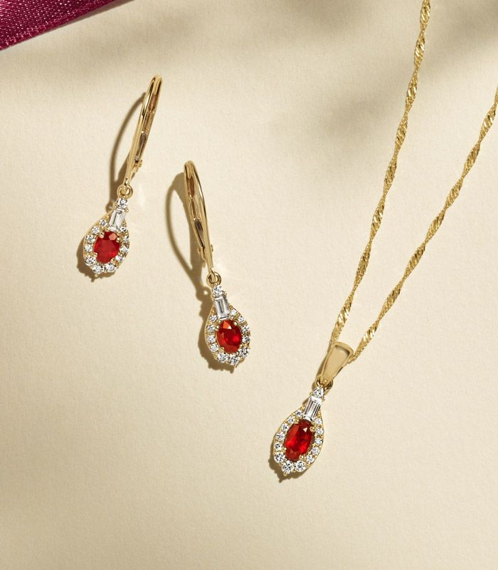 Mobile image of a ruby fashion pendant and matching fashion earrings