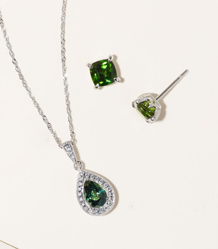 Mobile image of a chrome diopside fashion pendant and fashion stud earrings