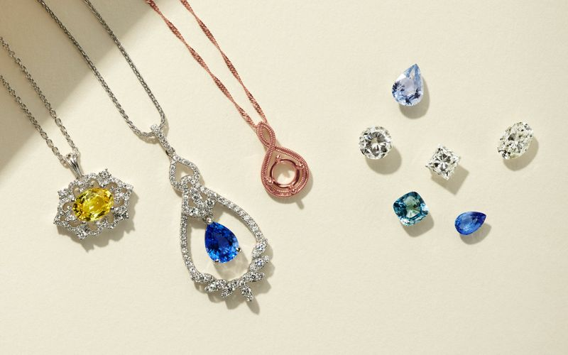 A collection of customized pendants and loose stones
