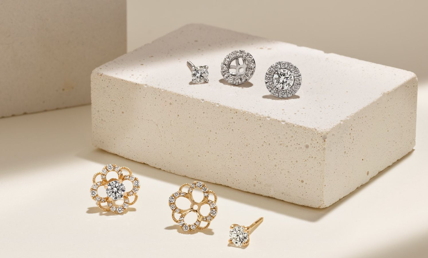 A collection of diamond studs and earring jackets