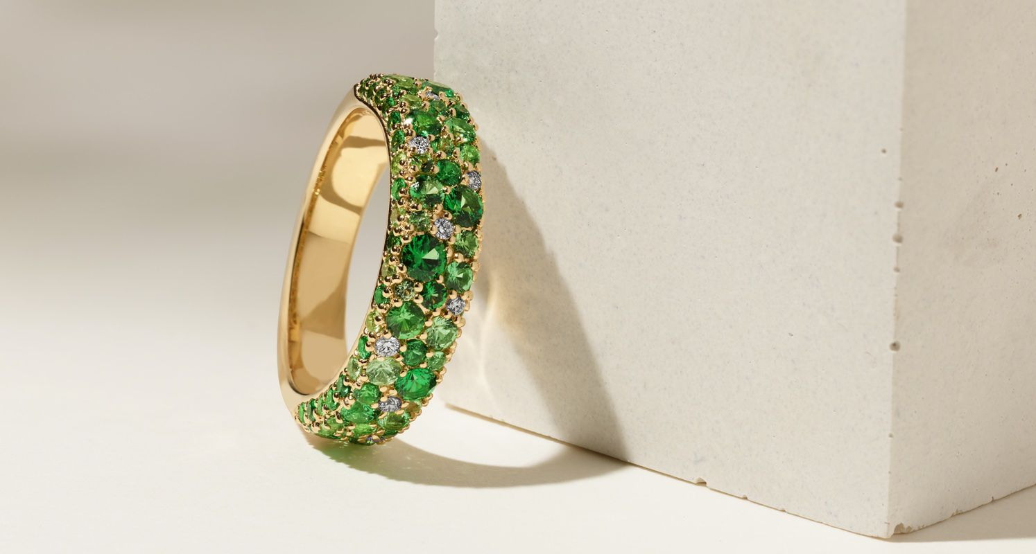 A fashion ring with green gemstones