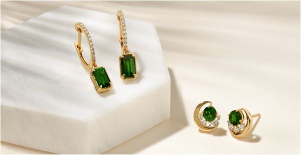 Mobile Image of two pairs of fashion earrings with green gemstones and diamonds