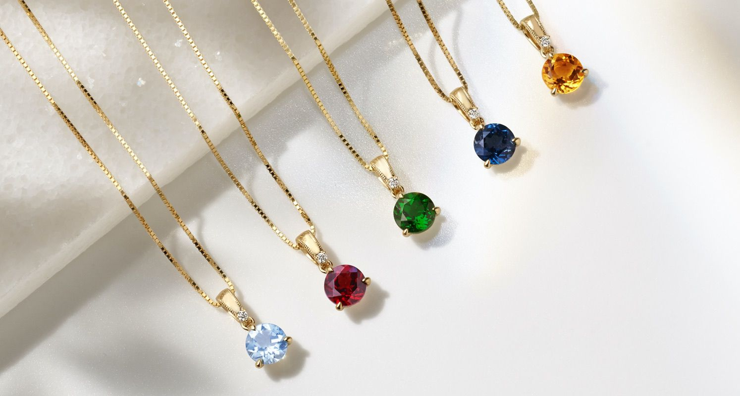 A collection of solitaire gemstone pendants