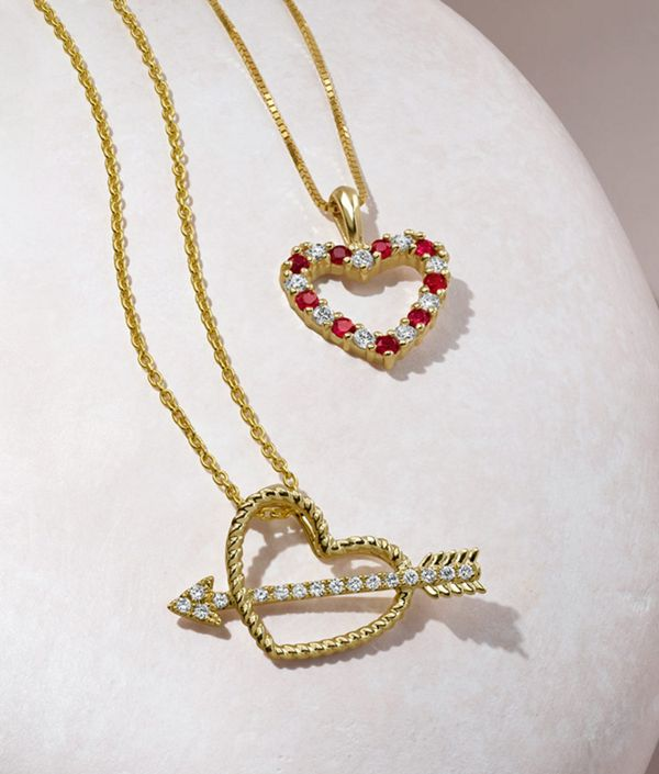 Mobile image of a collection of heart shaped fashion pendants