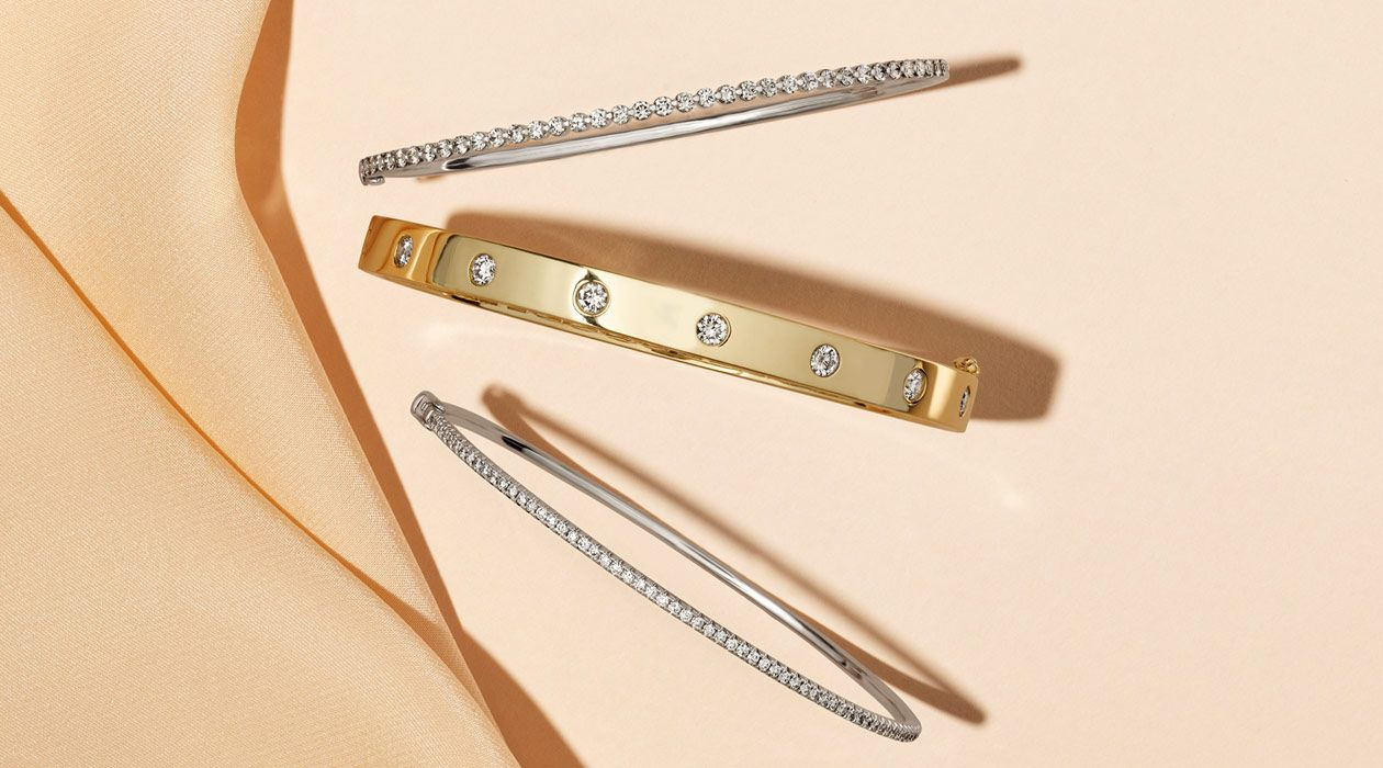 A collection of diamond bangle bracelets