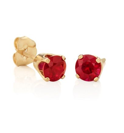 Round Rubies in Yellow Gold image