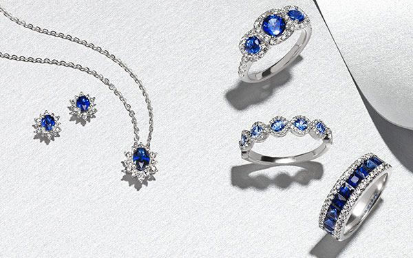 Three sapphire rings, sapphire necklace, and sapphire earrings