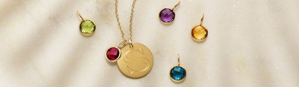 Mobile image of a collection of birthstone charms and an engraved disc charm