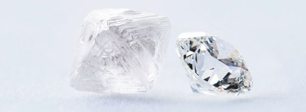 Mobile image of a rough diamond and a cut round diamond