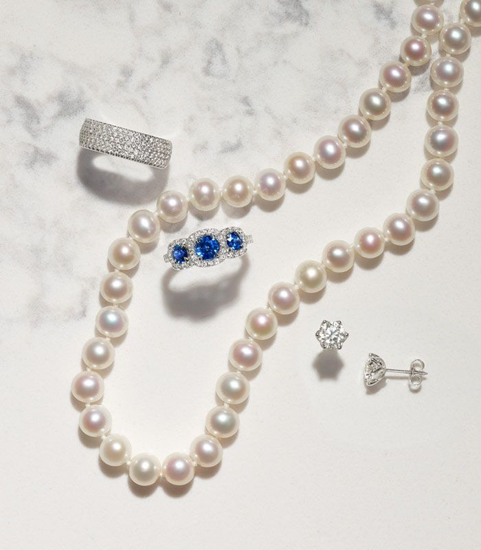 Diamond Ring, Pearl Necklace, Sapphire Ring, and Diamond Earrings