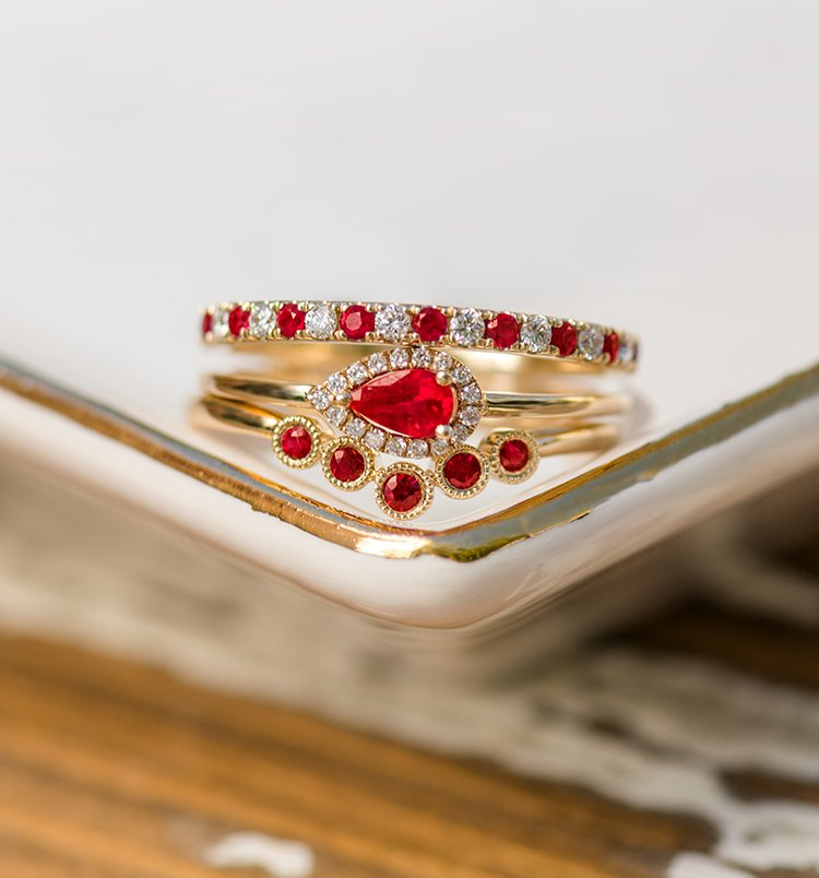 Collection of ruby rings stacked on top of each other