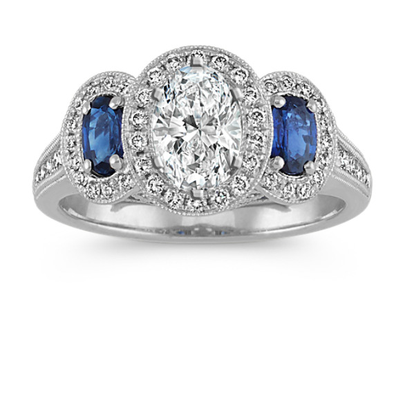 Oval Sapphire and Diamond Three-Stone Halo Engagement Ring