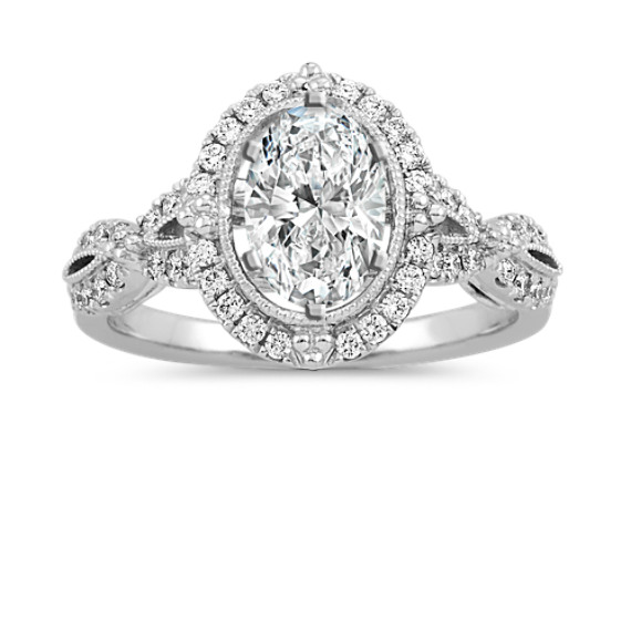 Vintage Diamond Halo Engagement Ring in Platinum