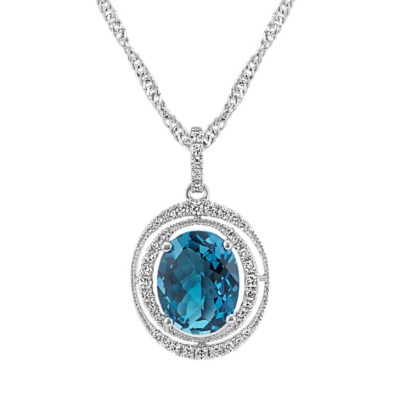 Oval London Blue Topaz and Round Diamond Halo Pendant (18 in)