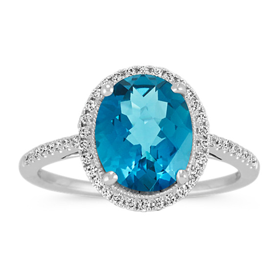 Oval London Blue Topaz and Round Diamond Halo Ring